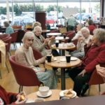 Residents enjoying a well earned break on a day out
